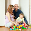 Happy family plays in home - Stock Photo