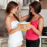 Two women testing soup — Stock Photo #15263993