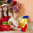 Royalty-Free Stock Photo: Girl with christmas gifts