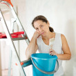 Weariness wommakes repairs at home — Stock Photo #15265953
