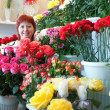 Woman in floral store — Stock Photo