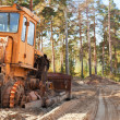 Tractor in forest — Stockfoto #15266473