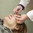 Ophthalmologist measures the ocular tension — Stock Photo