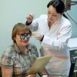 Ophthalmologist and patient testing eyesight — Stock Photo #15267739