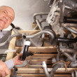 Mature man   in  auto parts store - Stock Photo