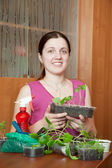 Girl with various seedlings — Stock Photo