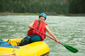 Girl with a paddle — Stock Photo