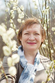 Senior woman in spring willow twig — Stock Photo