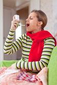 Illness woman uses spray — Stock Photo