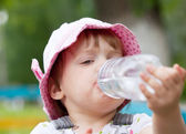 2 years baby drinks from bottle — Stock Photo