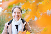 Mature woman in autumn — Stock Photo