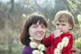 Happy mother with girl in spring — Stock Photo