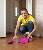 Woman sweeping the floor — Stock Photo
