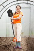Happy mature woman in hothouse — Stock Photo