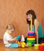 Mother and baby plays at home — Stock Photo