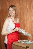 Maid steals money from table — Stock Photo
