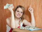 Woman decides on the financial problems — Stock Photo