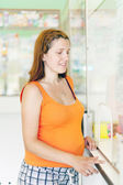 Pregnant woman buys drugs in pharmacy — Stock Photo
