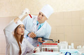 Male doctor and nurse in medical laboratory — Stock Photo