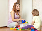 Happy mother plays with baby — Foto Stock