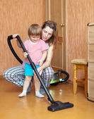 Mother and daughter chores with vacuum cleaner — Stok fotoğraf