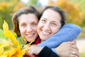 Happy mature woman with adult daughter — Stock Photo