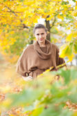 Woman in september park — Stock Photo