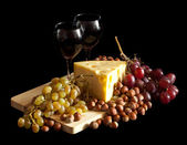 Grapes and cheese with glasses — Stock Photo