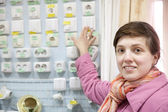 Woman chooses socket in store — Stock Photo