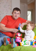 Father and three-year child plays in home — Stock Photo