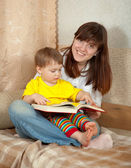 Mother and daughter reading book — Stock Photo