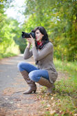 Girl with photocamera at september — Stock Photo