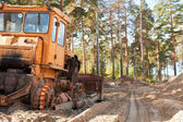 Tractor in the forest — Stock Photo