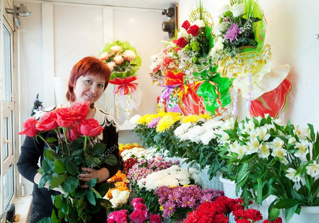 Middle-aged woman in  flower shop  Stock Photo #15265653