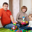 Family of three in home - Stock Photo