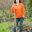 Royalty-Free Stock Photo: woman plants tree  in  garden