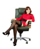 Happy woman sitting on office armchair — Stock Photo