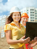 Two builders standing at building site — Stock Photo
