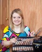 Woman putting make up — Stock Photo