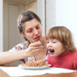 Mother feeding her 2 years child — Stockfoto #18198571