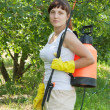 Female gardener working with garden spray — Stock Photo #18198595