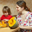 Stock Photo: Mother with daughter cooking pumpkin at kitchen