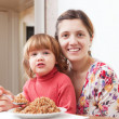 Stock Photo: Family eats buckwheat