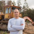 Portrait of tractor operator - Stock Photo