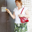Woman opening door with electronic key — Stock Photo