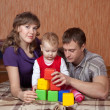 Stock Photo: Parents with toddler in home