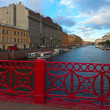 Red Bridge through Moyka River - Stock Photo