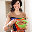 Stock Photo: Beauty womwith buckwheat cereal