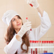 Nurse works with blood sample — Stock Photo