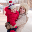 Stock Photo: Happy mother with toddler in winter